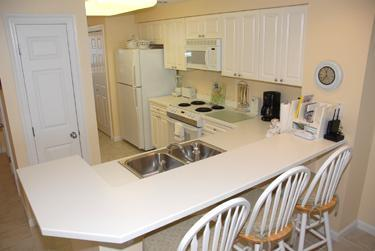 Kitchen with counter/stools, filtered water faucet