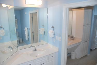 Master Bedroom with full vanity and make-up vanity in adjacent Master Bedroom
