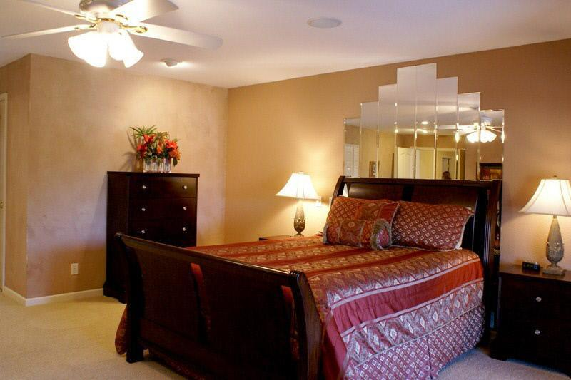West Coast Villa I Large Master Bedroom with a queen bed, access to balcony,