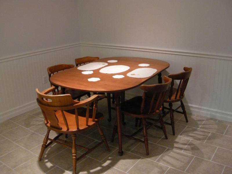 Large dining room table which can be extended in the lower unit.
