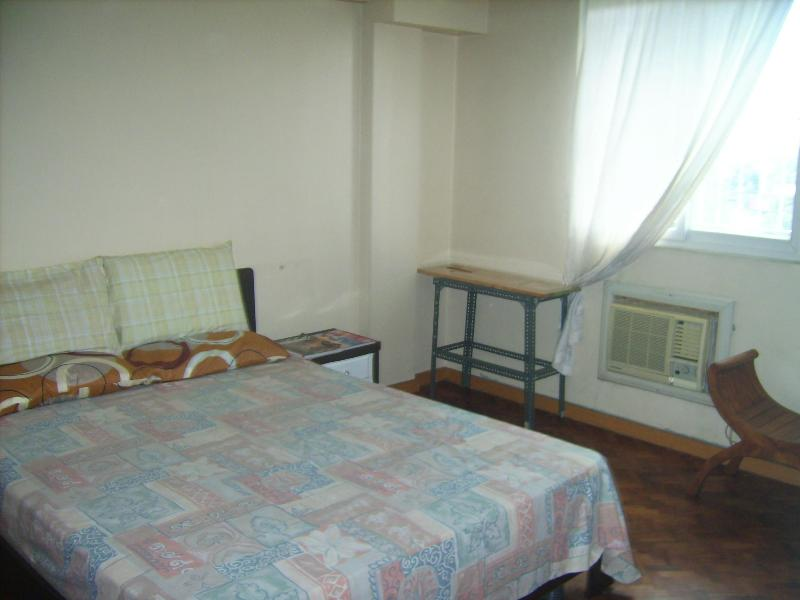 master's bedroom, airconditioned, queen bed, dresser, chair, provision for extra mattess if needed