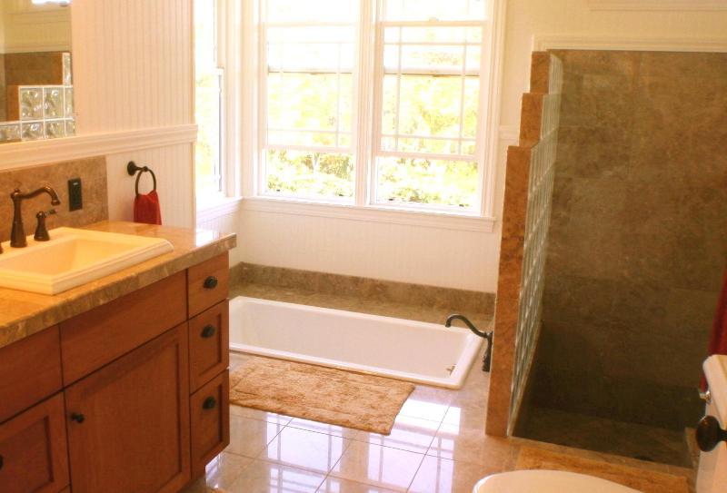 master bath with sunken tub, sunken marble shower