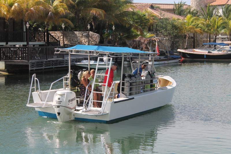 Dive Boat from our on site dive shop leaving our dock with four divers.  Small Boutique Dive Shop!