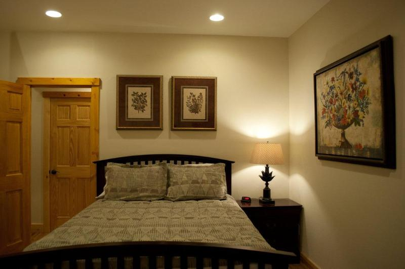 Semi Master Bedroom with fireplace and access to the lower deck