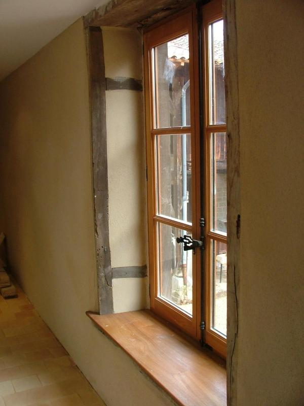 Window in the corridor of the coach house