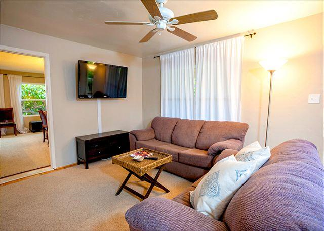 Living room with 52' flat screen TV complete with DVD and complimentary Netflix for all guests