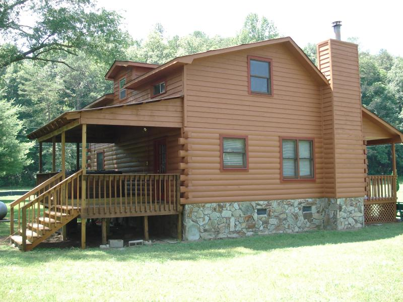 The covered back deck facing creek is where to enjoy the  hot tub or just sit and enjoy the creek