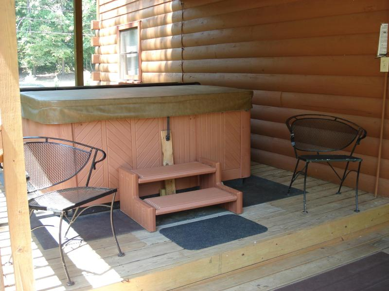 Enjoy the hot tub rain or shine under the covered back deck