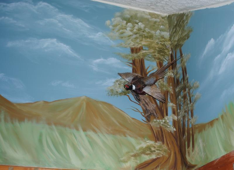 No need to leave the cabin to enjoy local artist's work on mural above the kitchen
