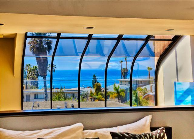 Enjoy amazing ocean and sunset views from this unique Windansea condo.