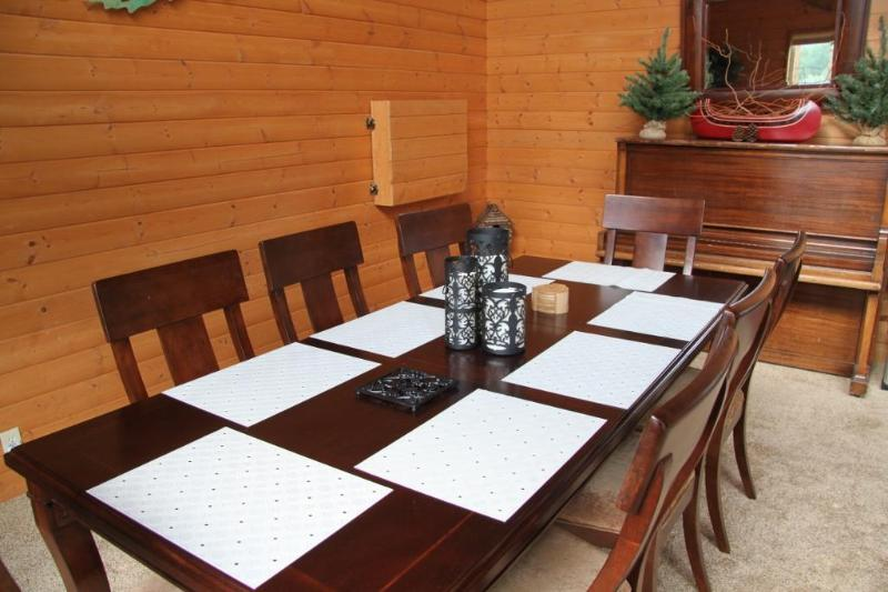 Large dining table seats 8, plus 5 at kitchen island.