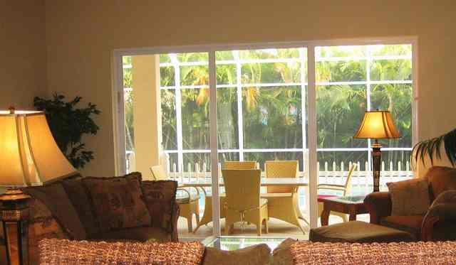 Family room overlooking lanai and pool