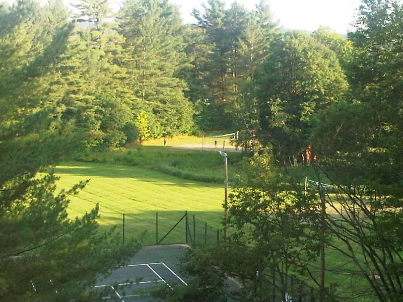 Two lighted  tennis courts seen from our deck