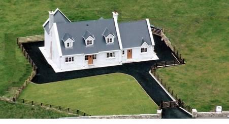Aerial View of Beach House, enclosed garden, tarmacadam drive around.