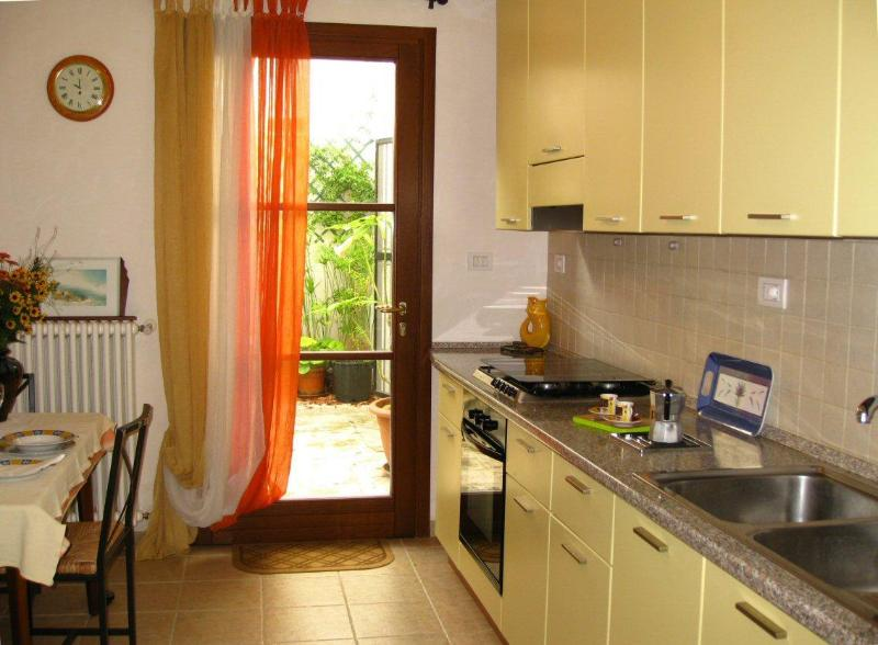 Kitchen with door to stone courtyard - great for breakfasts