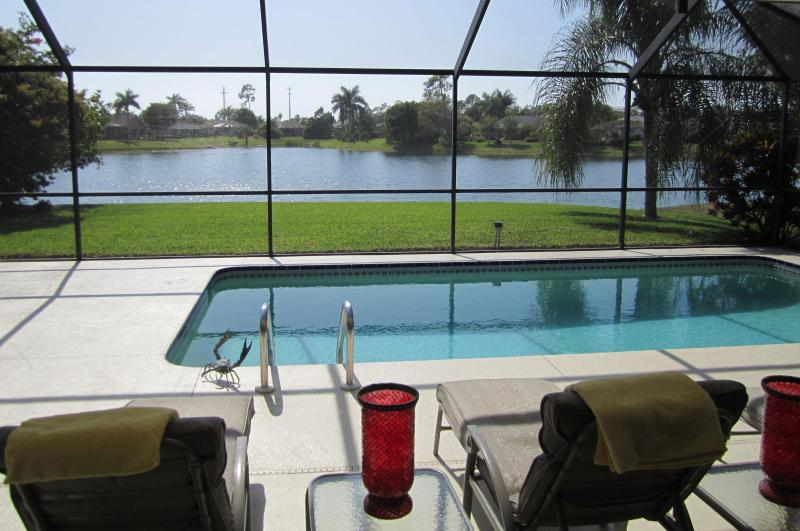 Sunny, private western exposure pool and patio/lanai with view on lake