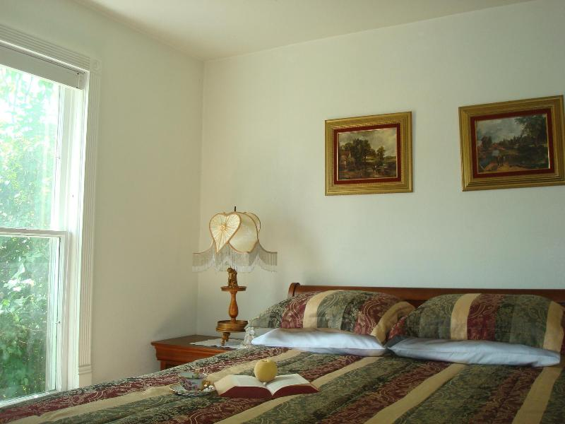 MASTER BEDROOM IS FURNISHED WITH A QUEEN SIZE BED
