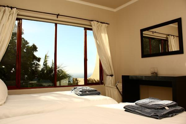 Bedroom 5 with sea and garden views