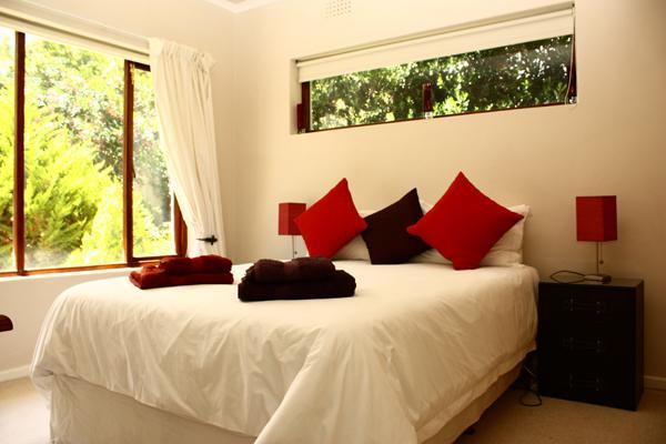 Bedroom 4 with garden and mountain views