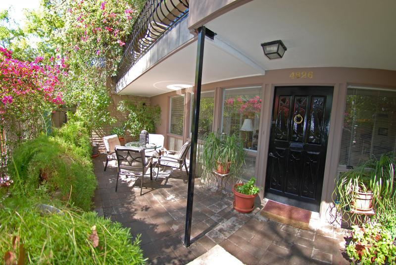 Sunny, lushly landscaped front patio is truly an oasis in the desert