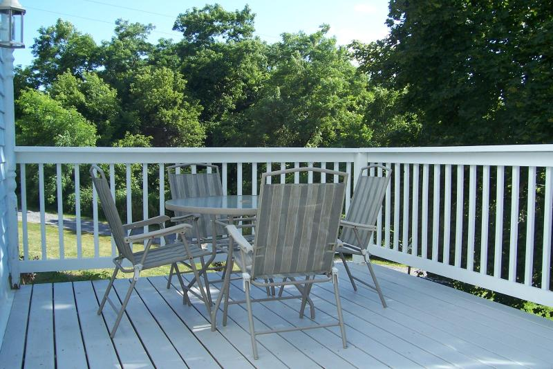 balcony off living room, a great place to sip your favorite beverage in the evening