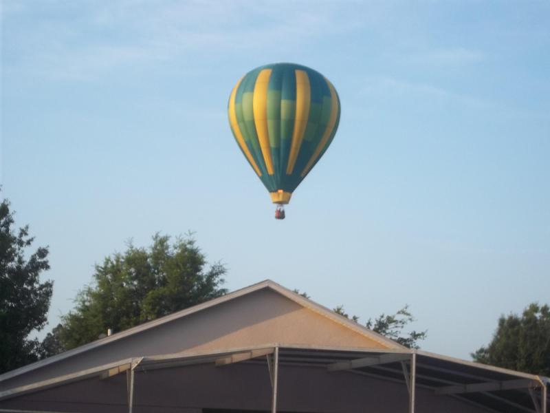 Hot Air Balloon Flying over villa regularly