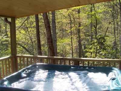 Each Cabin has  Hot Tub on the Covered Porch