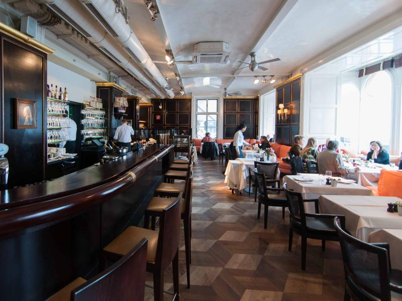 2 minutes walk: the very cosy and classy cafe on the first floor of Meinl, Graben street