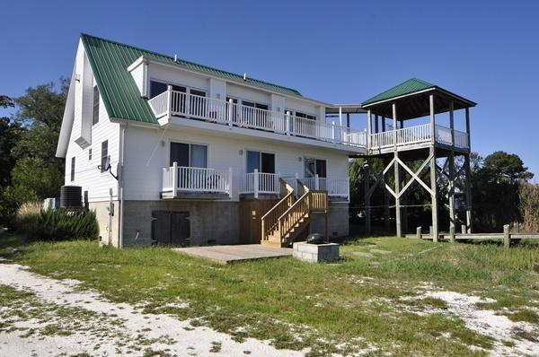 Epiphany on Deep Hole Creek:   Rear of House: Ground Level Deck, Observation Deck, BBQ