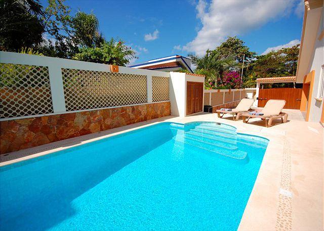 Relaxing by the pool at Villa Serenity, Aventuras Akumal