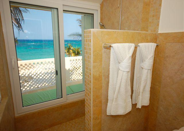 Upper ensuite bathrooms with ocean view showers!