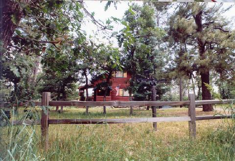 Set Back from Rural Road on 1/2 Acre