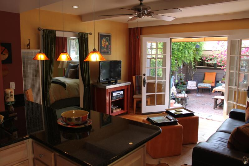 Living room area with Open doors to patio
