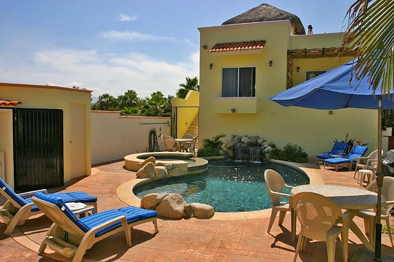 Pool, Jacuzzi, waterfall, and lounge furniture