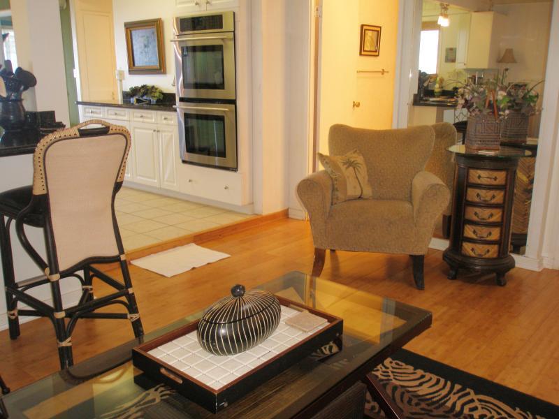 Living room facing kitchen and 2nd bathroom door.