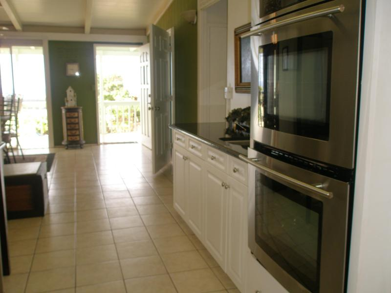 View from Kitchen to front door and balcony, Kitchen wet bar with Double Oven,