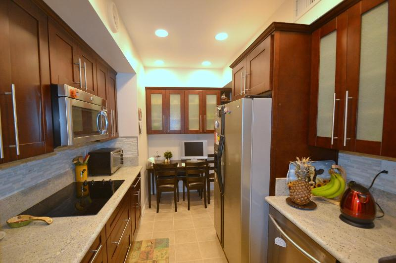 Fully loaded kitchen with new cabinetry and granite countertops