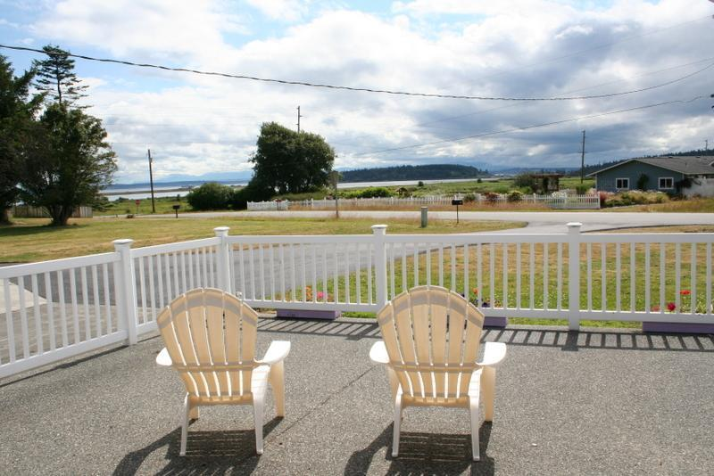 Relax on front patio and watch sunrises, sunsets, sailboats and ships go by