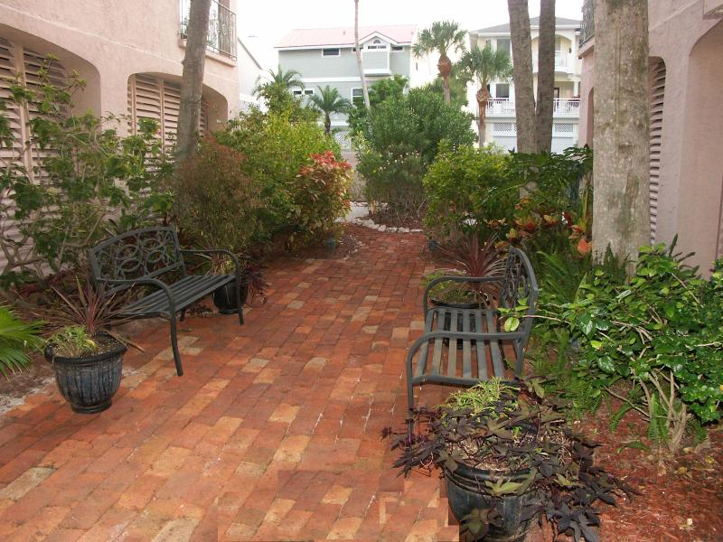Professionally landscaped grounds include this cobblestone courtyard.