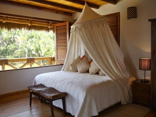 King size bed with an ocean view in Casa Coco's main floor level