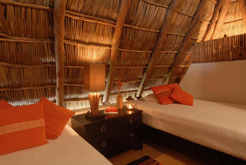 A twin and full bed await you in the Palapa suite