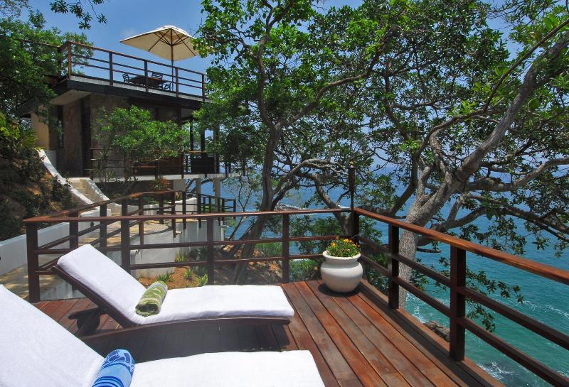 The yoga deck with lounge chairs outside of Casa Mirador