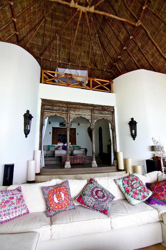 Main Villa living room beneath the beautiful 60 foot palapa ceiling