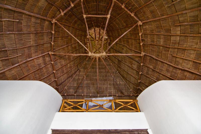 Marvel at the beautiful 60 foot palapa ceiling
