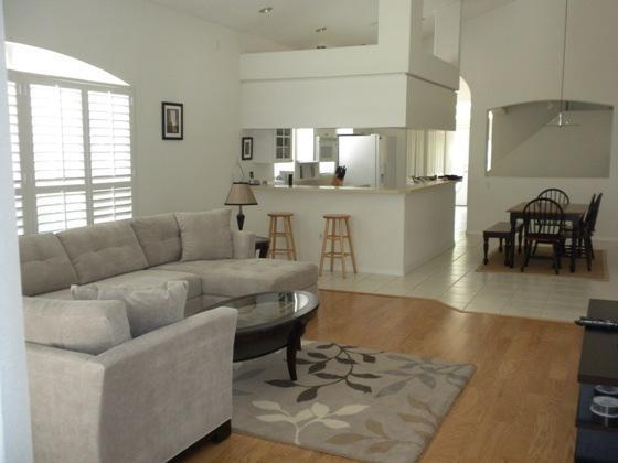 Open floor plan with high ceilings and lots of windows