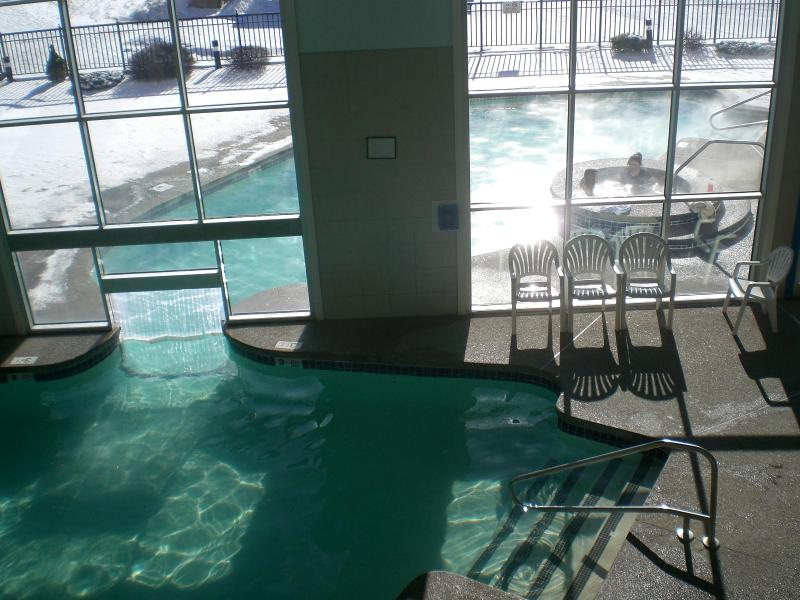 Indoor heated pool with swim through to outside heated pool