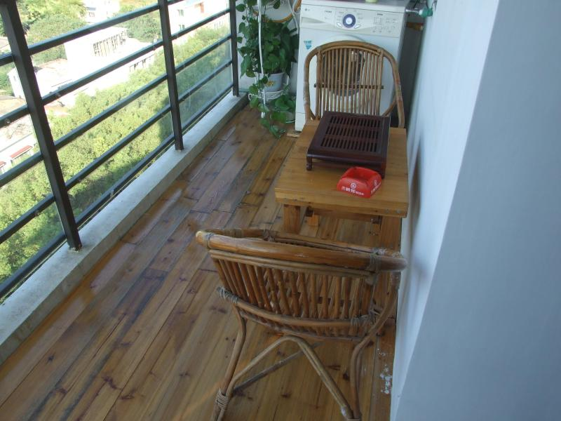 1st balcony with  washing machine, outdoor smoking area