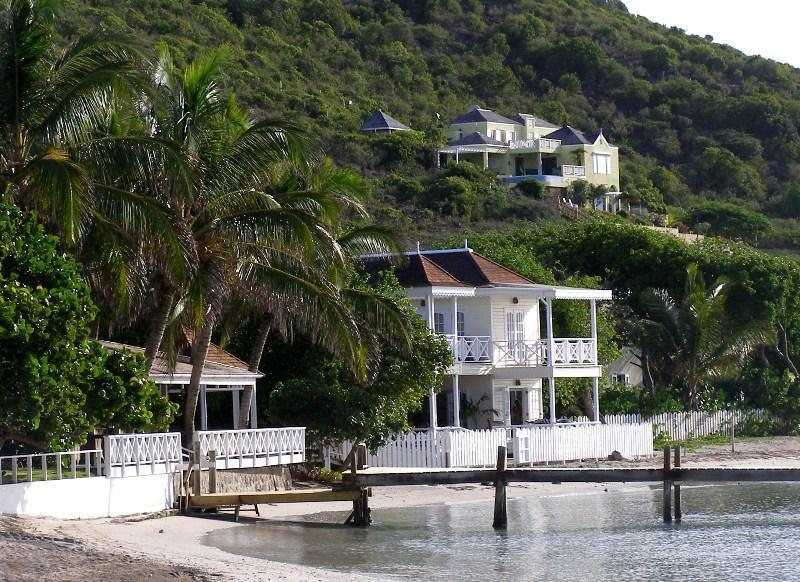 Ocean Song Villa in back ground 4 minute walk to beach with your private Beach Front Lounge shown.