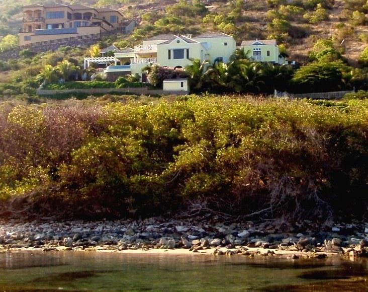 Ocean Song Villa. Turtle grass beds and sand pools in foreground create marine nurseries.