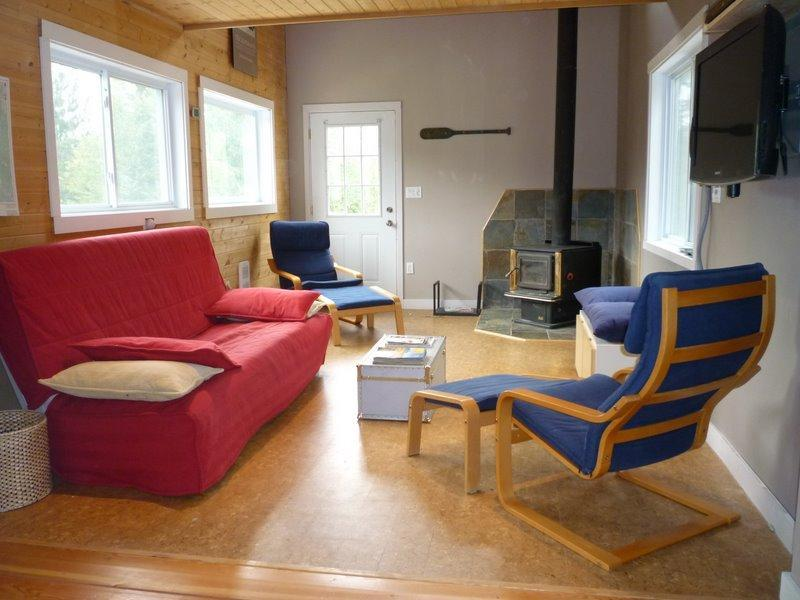relax in a comfortable living room by the wood fireplace, enjoy a movie on our flatscreen TV, or drop your IPOD into our stereo and wind down after a day of playing in the mountains